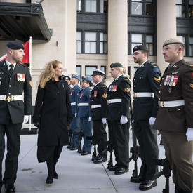 Upon arrival at the Senate of Canada Building, she inspected a guard of honour.