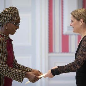 The Ambassador-designate of the Republic of Zimbabwe hands letters of credence to the Governor General.