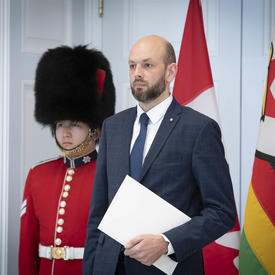 The Ambassador-designate of the Republic of Lithuania readies to hand letters of credence to the Governor General.