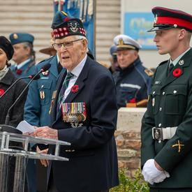 Canadian war veteran delivers remarks.