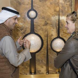 A guide gives the Governor General a tour of the Kuwait Towers.