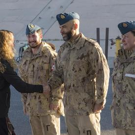 Governor General Julie Payette shakes hands with a Canadian Armed Forces member.