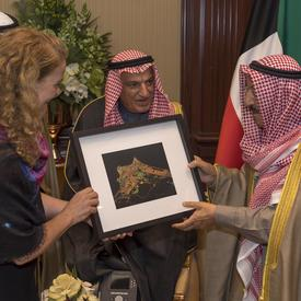 Governor General of Canada Julie Payette presents a framed photography to the Emir of Kuwait.