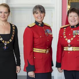 Brenda Butterworth-Carr poses with the Governor General and RCMP Commissioner Brenda Lucki.  All three are wearing their insignia.