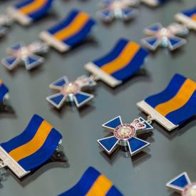 The badge of the Order of Merit of the Police Forces displayed on a table.