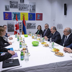 The Governor General met with President of the Republic of Armenia, Armen Sarkissian are sitting around a table with other government officials.