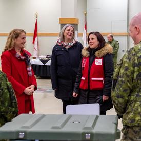 The Governor General discusses with staff at CFB Trenton.
