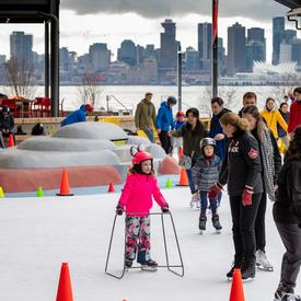 The Governor General skates with members of the community.