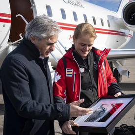 The Governor General presents the mayor of Thunder Bay with a picture of the city taken from space.