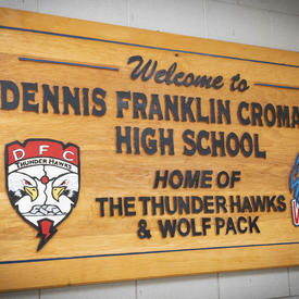 A photo of a Dennis Franklin Cromarty High School wooden sign.