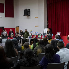 The Governor General delivers a presentation at a high school.
