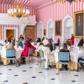 A photo of the guests sitting at tables.