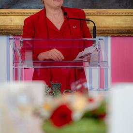 The Governor General spoke from a podium.