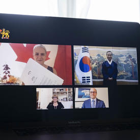 A computer screen split in 4 rectangles with a person in each one, 2 women and 2 men. Top left rectangle shows a Canada flag behind a woman, holding a certificate-like paper. On her right, a man is standing next to the Korea flag.