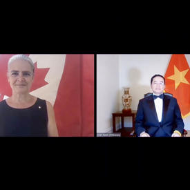 A computer screen split in two shows a woman on the left, standing in front of a Canadian flag. On the right, a man wearing a suit and bow tie is sitting in front of the flag of Vietnam.