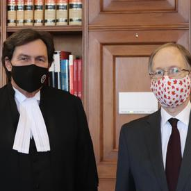 Administrator Wagner and Ian Shugart standing next to each other. Both wearing masks.