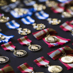 Honours decorations and medals are displayed on a table covered by black cloth.