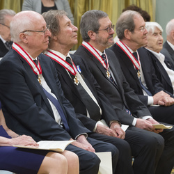 A row of seated recipients, their Order of Canada insignias are visible around their neck.