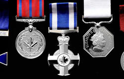 The Order of Merit of the Police Forces (Officer), the Medal of Bravery, the Meritorious Service Cross (Military Division), the Polar Medal and the Sovereign's Medal for Volunteers are displayed.