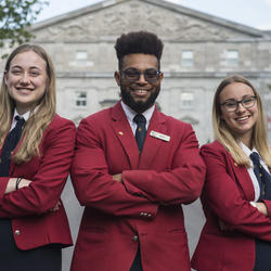 Three tour guides in front of Rideau Hall