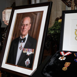 Portrait of the Duke and a display of medals are propped up on a table.