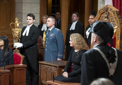 The Governor General sits in the Senate Chamber.