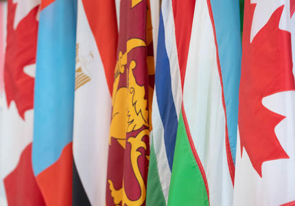The flags of Mongolia, Egypt, Sri Lanka, The Gambia, and Uzbekistan are side by side.