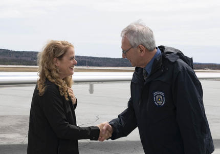 The Governor General is greeted by someone from New Brunswick's Emergency Preparedness team.