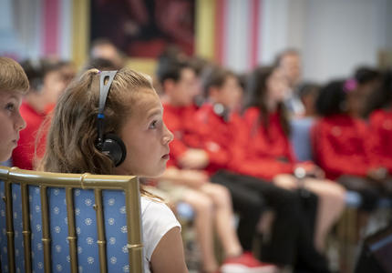 A young student listens intently during the question and answer session with the Governor General.