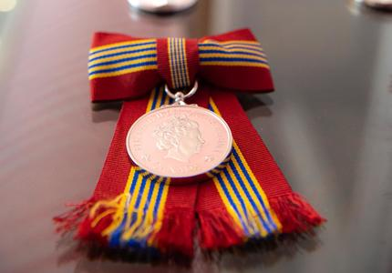 Close-up of the medals being bestowed.