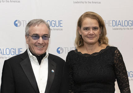 Daniel Lamarre, President and CEO of Cirque du Soleil, and Governor General of Canada, Julie Payette, standing in front of a banner with multiple The Dialogue Leadership to the Americas logo.