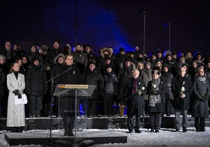 La gouverneure générale prononce une allocution à un podium lors de la cérémonie commémorative de la Polytechnique.
