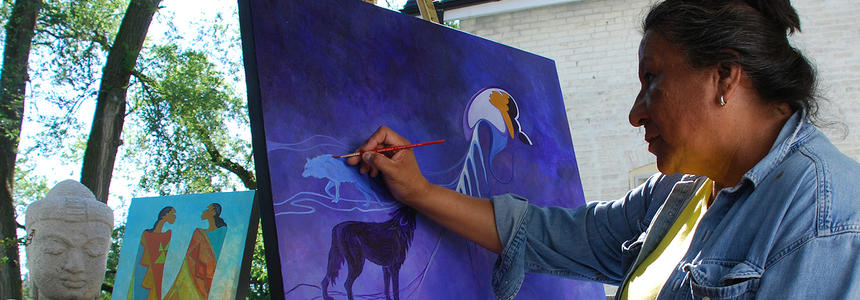 Maxine Noel painting a canvas