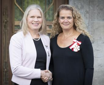 Polar Medal recipient Susan Chatwood shaking hands with Her Excellency The Right Honourable Julie Payette, Governor General of Canada
